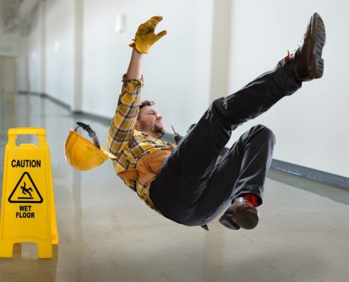 man slipping on a wet floor without anti slip paint